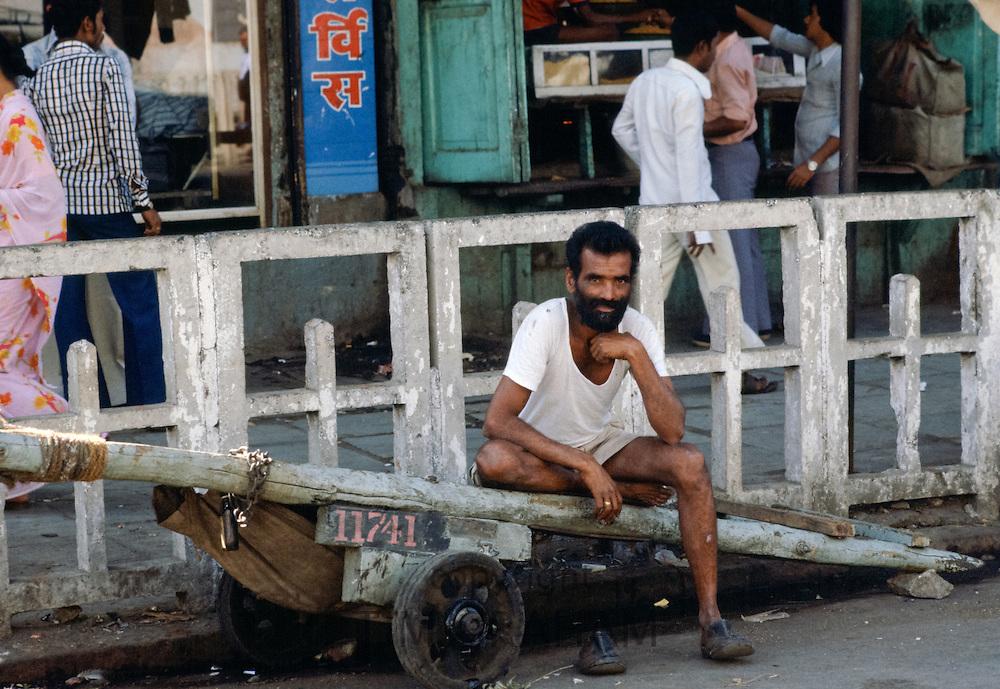 Indian porter taking a break