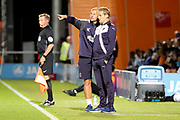 AFC Wimbledon assistant coach Neil Cox talking to AFC Wimbledon manager Neal Ardley during the EFL Trophy match between Barnet and AFC Wimbledon at Underhill Stadium, London, England on 29 August 2017. Photo by Matthew Redman.
