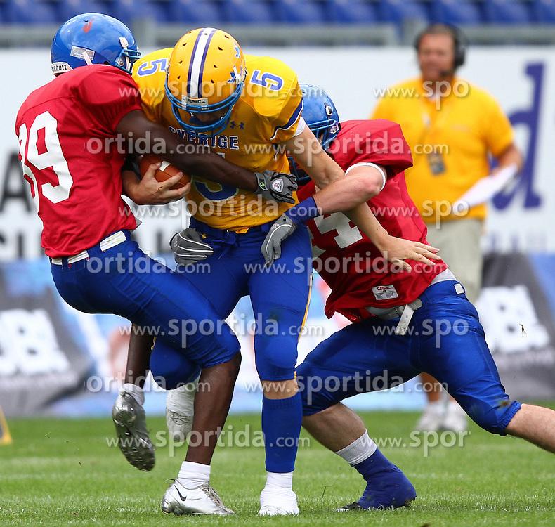 29.07.2010, Brita Arena, Wiesbaden, GER, Football EM 2010, Team Sweden vs Team Great Britain, im Bild Anders Hermodsson, (Team Sweden, QB, #5) wird von Leslie Oluwu-Wilson, (Team Great Britain, DB, #39) und Lee Collins, (Team Great Britain, LB, #44) in die Zange genommen,  EXPA Pictures © 2010, PhotoCredit: EXPA/ T. Haumer / SPORTIDA PHOTO AGENCY