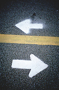 directional arrows on asphalt