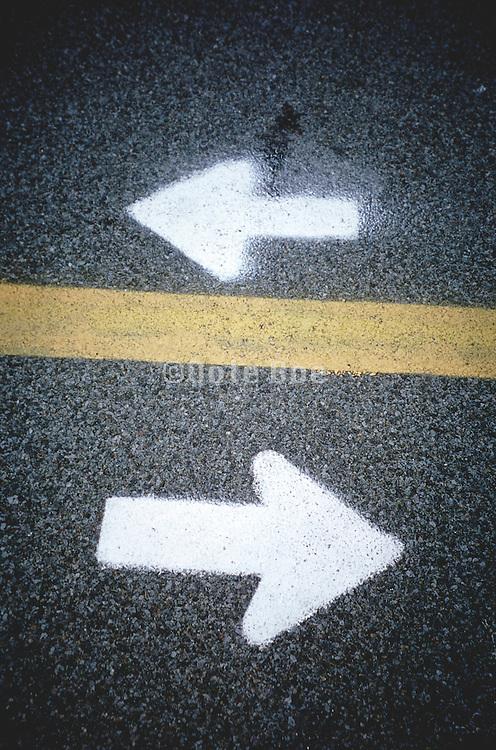 directional arrows on asphalt