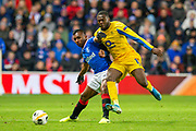 Alfredo Morelos (#20) of Rangers FC shields the ball from Chancel Mbemba (#19) of FC Porto during the Group G Europa League match between Rangers FC and FC Porto at Ibrox Stadium, Glasgow, Scotland on 7 November 2019.