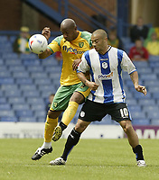Photo: Aidan Ellis.<br /> Sheffield Wednesday v Norwich City. Coca Cola Championship. 06/05/2007.<br /> Norwich's Deon Dublin Challenges Wednesday's Deon Burton