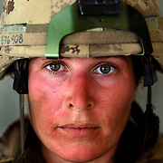 Aug 13, 2009 - Kandahar Province, Afghanistan - Canadian Medic Mcpl. Marie Gionet age 31, seen after a Patrol in extreme heat in the volatile Panjway District located west of Kandahar City, Afghanistan. This is Canada's first combat deployment since the Korean War. Canada has suffered one of the highest casualty rates of the war in Afghanistan and has announced that it will be pulling out all Canadian combat troops by 2011. Canada has recently began handing over these violent districts to US Forces who have begun to sustain numerous casualties. Mcpl. Gionet is one of several Canadian women who serve on the front lines, as Canada unlike many other countries allows women to serve in combat units.<br /> The Canadian Press Images/Louie Palu<br /> CANADIAN SALES AND USE ONLY. NO INTERNATIONAL SALES OR USE.