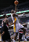 March 13, 2012; Indianapolis, IN, USA; Indiana Pacers center Roy Hibbert (55) shoots ball as Portland Trail Blazers power forward LaMarcus Aldridge (12) defends at Bankers Life Fieldhouse. Mandatory credit: Michael Hickey-US PRESSWIRE
