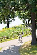 Bicycler enjoying ride among the many paths of the Lake Phalen Park. St Paul Minnesota USA