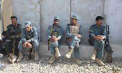 © Licensed to London News Pictures. FILE PICTURE DATED: 22/08/2011 . Members from one rifles working with afghan national police in Helmand, Afghanistan. NATO has announced plans to cut back on operations with the Afghan army because of the coalition's high losses from 'green on blue' attacks. Photo credit: Sergeant Alison Baskerville/LNP