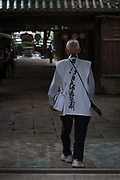 A Pilgrim, known as a Henro, enters Ishite temple on the Shikoku 88 Temple pilgrimage, Matsuyama, Eihime, Japan.. Friday, June 26th 2015