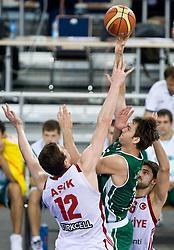 Omer Asik of Turkey and Erazem Lorbek (15) of Slovenia during the EuroBasket 2009 Group F match between Slovenia and Turkey, on September 16, 2009 in Arena Lodz, Hala Sportowa, Lodz, Poland.  (Photo by Vid Ponikvar / Sportida)