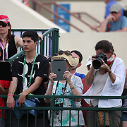 Fans look on as Roger Federer practices at the Indian Wells Tennis Garden in Indian Wells, California Tuesday, March 11, 2015.<br /> (Photo by Billie Weiss/BNP Paribas Open)