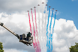 London, UK. 8 June, 2019. The Red Arrows, the Royal Air Force Aerobatic Team, take part in a flypast over the Mall and Buckingham Palace after the Trooping the Colour ceremony to mark the Queen's official birthday.