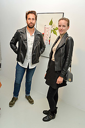 DIEGO BIVERO-VOLPE and CHARLOTTE CARROLL at the launch of SunSoul - a new energy drink held at Rook & Raven Gallery, 7 Rathbone Place, London on 14th June 2016.