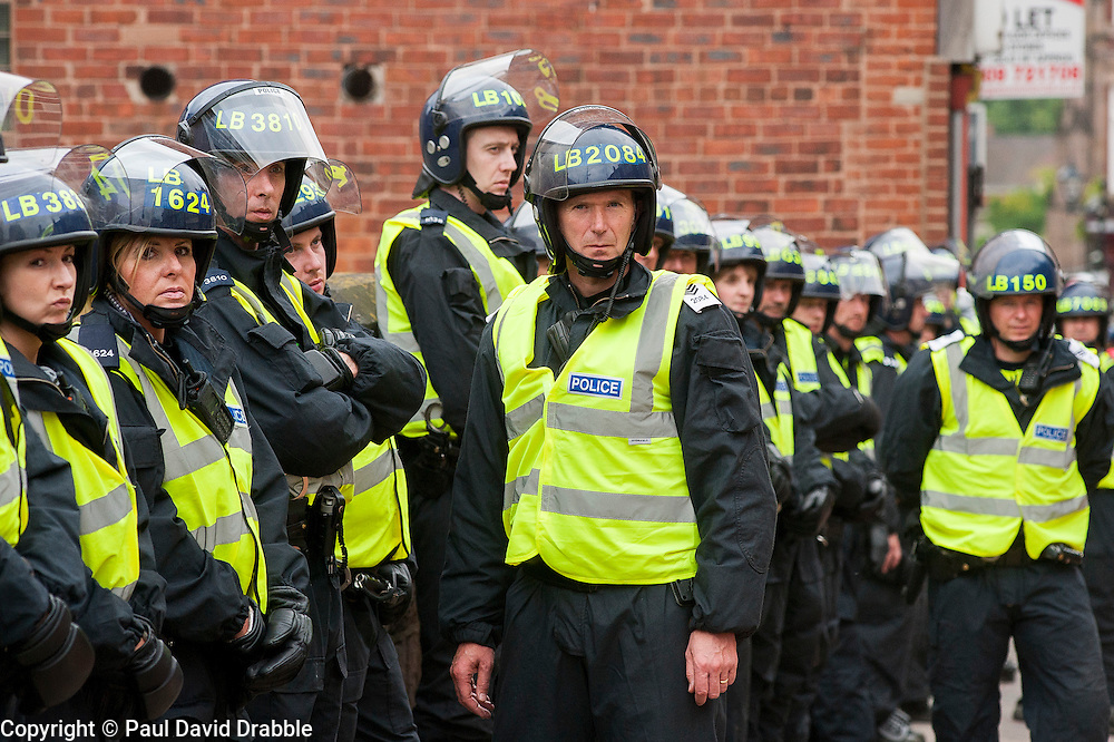 """Rotherham England<br /> 13 September 2014 <br /> Police officers from, Devon & Cornwall,  Wales, Thames Valley were amongst the officers draughted in to Assist South Yorkshire Police deal with the EDL  (English Defence League) Justice for the Rotherham 1400 which was described by an EDL Facebook Page as """"a protest against the Pakistani Muslim grooming gangs"""" on Saturday Afternoon <br /> <br /> <br /> Image © Paul David Drabble <br /> www.pauldaviddrabble.co.uk"""