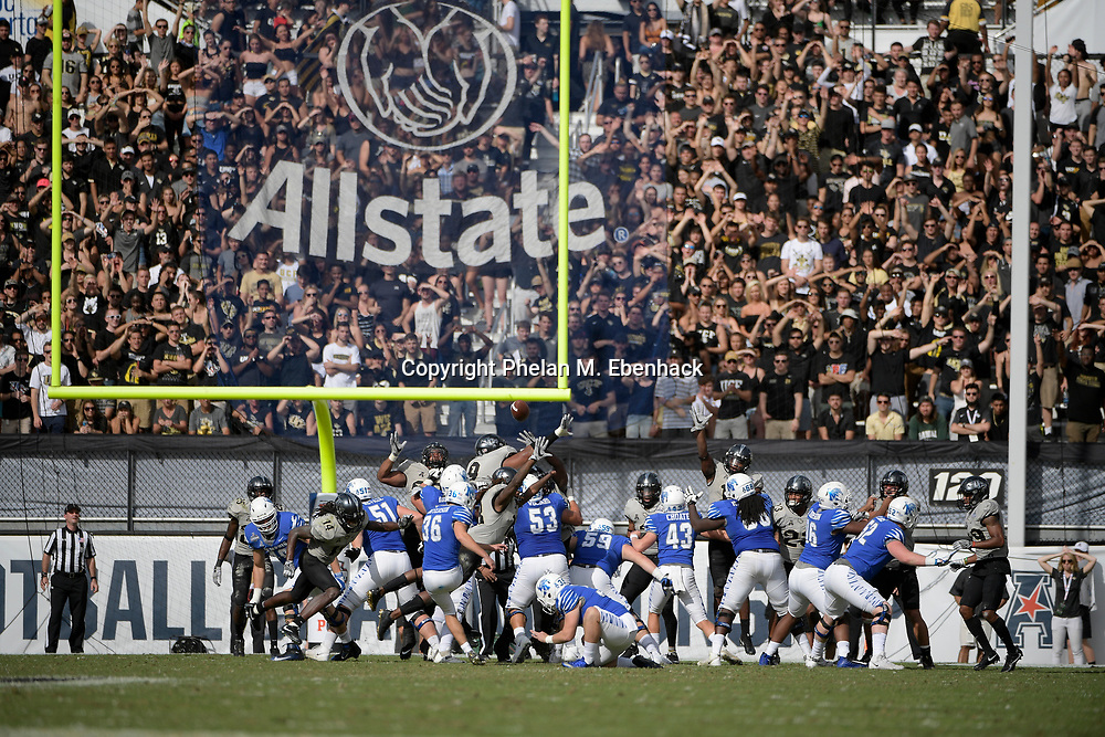 Memphis place kicker Riley Patterson (36) attempts a field goal during the first half of the American Athletic Conference championship NCAA college football game against Central Florida Saturday, Dec. 2, 2017, in Orlando, Fla. (Photo by Phelan M. Ebenhack)
