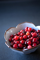 A bowl of fresh cranberries.