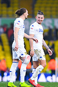 Kalvin Phillips of Leeds United (23) shares a joke with Luke Ayling of Leeds United (2) after the full time whistle during the EFL Sky Bet Championship match between Leeds United and Bolton Wanderers at Elland Road, Leeds, England on 23 February 2019.