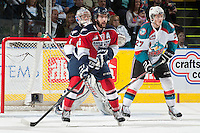 KELOWNA, CANADA - MARCH 23: Justin Hamonic #6 of the Tri-City Americans checks Ryan Olsen #27 of the Kelowna Rockets on March 23, 2014 at Prospera Place in Kelowna, British Columbia, Canada.   (Photo by Marissa Baecker/Shoot the Breeze)  *** Local Caption *** Justin Hamonic; Ryan Olsen;