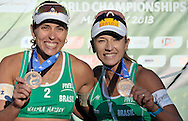 Bronze medalist Liliane Maestrini (L) and Barbara Seixas De Freitas (R) from Brazil while medal ceremony during Day 6 of the FIVB World Championships on July 6, 2013 in Stare Jablonki, Poland.