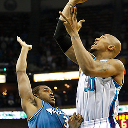February 1, 2011; New Orleans, LA, USA; New Orleans Hornets power forward David West (30) shoots over Washington Wizards center Trevor Booker (35) during the first quarter at the New Orleans Arena.   Mandatory Credit: Derick E. Hingle