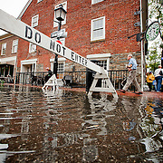 Alexandria, Sept. 30, 2010 - Rain and high tide flood lower King St. in Old Town Alexandria, Va., on Thursday, Sept. 30, 2010. (Photo by Jay Westcott/TBD)
