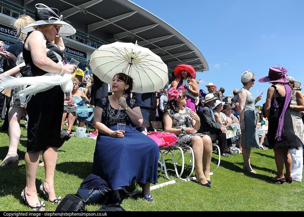 © licensed to London News Pictures. EPSOM, UK.  03/06/11. Epsom Derby Ladies Day. Sunshine and wind made for a busy Ladies Day today, 3rd June 2011.  Photo credit should read Stephen Simpson/LNP
