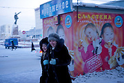 Street scene close to Lenin Square in the city of Yakutsk. Yakutsk is a city in the Russian Far East, located about 4 degrees (450 kilometres) south of the Arctic Circle. It is the capital of the Sakha (Yakutia) Republic in Russia with a major port on the Lena River. The city has a population of 264.000 (2009). Yakutsk is one of the coldest cities on Earth. The average monthly winter temperature in January is around -43,2 C. Yakutsk, Jakutsk, Yakutia, Russian Federation, Russia, RUS, 15.01.2010.