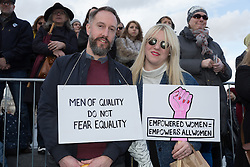 © Licensed to London News Pictures. 05/03/2017. LONDON, UK. A couple prepare to take part in the March4Women, organised by CARE International to mark International Women's Day. The Women's Day March begins at The Scoop near City Hall, before proceeding over Tower Bridge and finishing at the Tower of London. Photo credit: Vickie Flores/LNP
