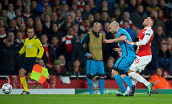 LONDON, ENGLAND - Tuesday, February 23, 2016: Barcelona's Javier Mascherano tackles Arsenal's Alex Oxlade-Chamberlain during the UEFA Champions League Round of 16 1st Leg match at the Emirates Stadium. (Pic by Kirsten Holst/Propaganda)