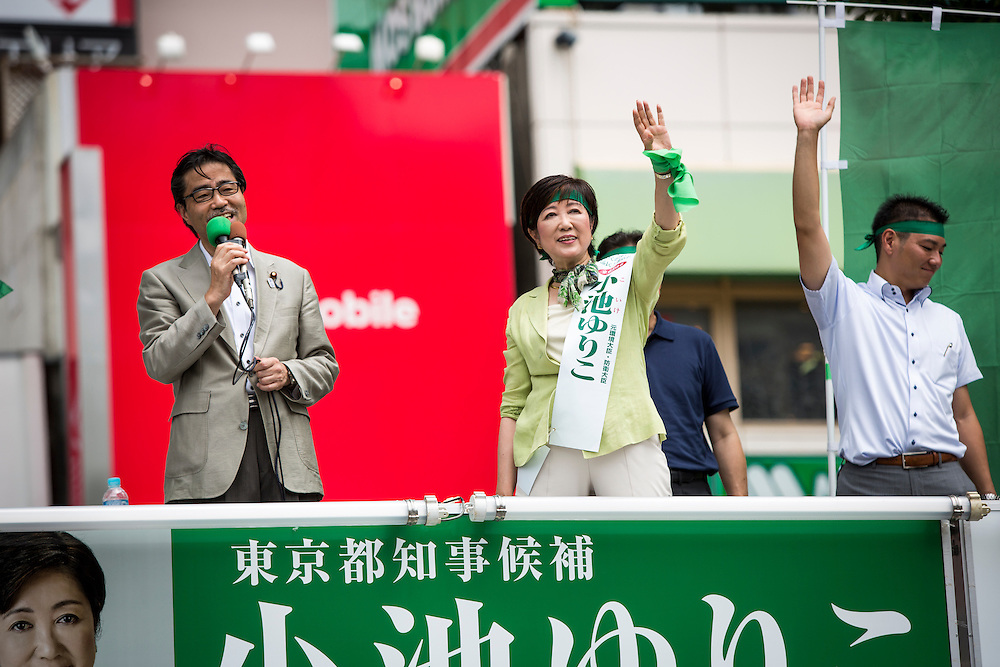 TOKYO, JAPAN - JULY 20 :  Masaru Wakasa, a politician from Liberal Democratic Party (LDP) delivers his speech to support candidate Yuriko Koike, a Liberal Democratic Party lawmaker and former defense minister during a speech campaign for the July 31 Tokyo gubernatorial election in front of Gotanda Station in Tokyo, Japan on Wednesday, July 20, 2016.   (Photo by Richard Atrero de Guzman/NUR Photo)