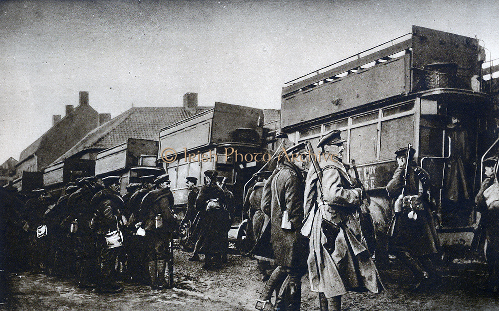 From billets to trenches by motor bus.  British soldiers about to board the familiar London vehicle somewhere in Flanders.