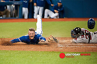 September 19 2015: Toronto Blue Jays Third base Josh Donaldson (20) [7086] dives to make home plate to score off Toronto Blue Jays Designated hitter Edwin Encarnacion (10) [4352]  RBI in the eighth inning during 7 - 6 loss against Boston Red Sox in the eighth inning at Rogers Centre in Toronto, ON, Canada.