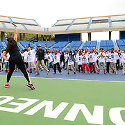 May 15, 2014, New Haven, Connecticut:<br /> Local kids participate in a Zumba dancing lesson during a free tennis lesson and clinic Thursday, May 15, 2014 in advance of the 2014 New Haven Open at the Yale University Tennis Center in New Haven, Connecticut. <br /> (Photo by Billie Weiss/New Haven Open)