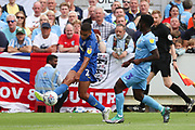 AFC Wimbledon defender Tennai Watson (2) taking on Coventry City defender Brandon Mason (3) and crossing the ball during the EFL Sky Bet League 1 match between AFC Wimbledon and Coventry City at the Cherry Red Records Stadium, Kingston, England on 11 August 2018.