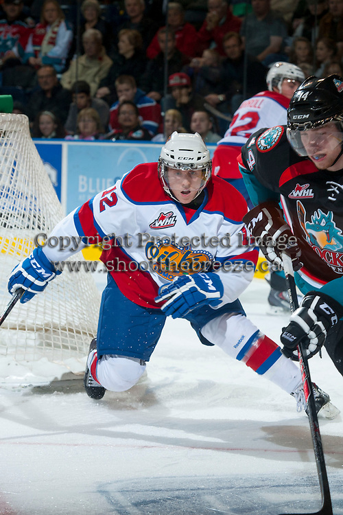 KELOWNA, CANADA - NOVEMBER 9: Cole Benson #12 of the Edmonton Oil Kings skates behind the net at the Kelowna Rockets on November 9, 2013 at Prospera Place in Kelowna, British Columbia, Canada.   (Photo by Marissa Baecker/Shoot the Breeze)  ***  Local Caption  ***