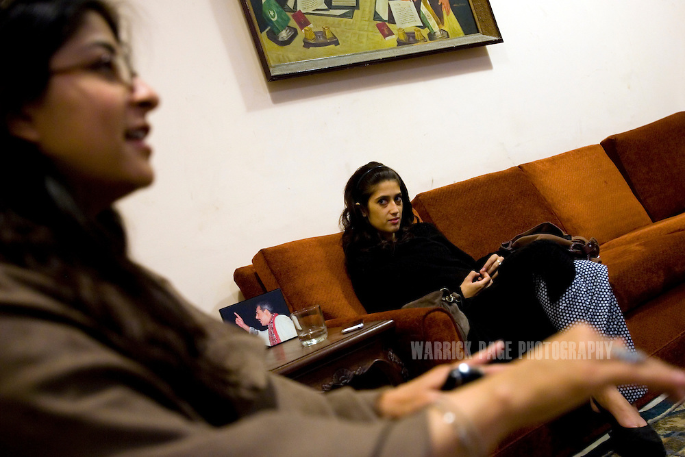 Fatima Bhutto (R), estranged niece of assassinated former prime minister, Benazir Bhutto, and granddaughter Zulfikar Ali Bhutto, sits in her home with close friend Sabeen Jatoi (L), February 3, 2008 in Karachi, Pakistan. Fatima is a writer and a poet whose father, Murtaza Bhutto, was assassinated by police during the premiership of Benazir Bhutto in 1996. It has been widely speculated that she will eventually enter politics; a rumour she strongly denies. (Photo by Warrick Page)