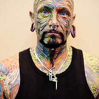 Manchester, UK - 5 August 2012: a tattooed man poses for a picture during the Manchester Tattoo Show, one of the most popular conventions of the UK tattoo community.
