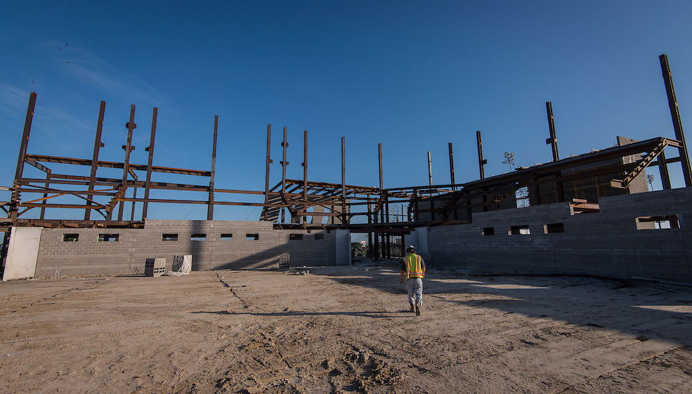 Construction crews work on the new Delmar-Tusa Fieldhouse, July 14, 2015.