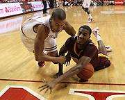 January 12, 2012:  -  Indiana Hoosiers guard Verdell Jones III (12) and Minnesota Golden Gophers guard Austin Hollins (20) battle for a loose ball during an NCAA basketball game between the Minnesota Golden Gophers and #7 ranked Indiana Hoosiers at Assembly Hall in Bloomington, Indiana. Minnesota beat Indiana 77-74.