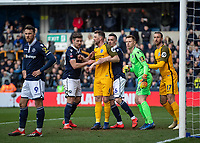 Football - 2018 / 2019 Emirates FA Cup - Sixth Round, Quarter Final : Millwall vs. Brighton<br /> <br /> Millwall players jostle with Brighton players as they wait for the corner to come in at The Den.<br /> <br /> COLORSPORT/DANIEL BEARHAM