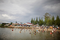 Indonesians enjoy a lagoon that was formed from the tsunami, in the town of Ulele, just outside of Banda Aceh, Sunday, Nov. 8, 2009.