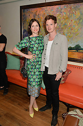 SOPHIE ELLIS-BEXTOR and RICHARD JONES at the 50th anniversary party for Daphne's restaurant, 112 Draycott Avenue, London held on 24th June 2014.