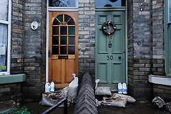 © Licensed to London News Pictures. 29/12/15<br /> York, UK. <br /> <br /> Freshly delivered milk stands on sandbags in doorways as flood water begins to subside on Huntington Road in York. Further rainfall is expected over coming days as Storm Frank approaches the east coast of the country.<br /> <br /> Photo credit : Ian Forsyth/LNP