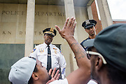Baltimore, Maryland - April 20, 2015: Baltimore Police Lt. Col. Melvin T. Russell listens to demonstrators gathered outside the Western District Police Station in Baltimore Monday to protest the death of Freddie Gray.<br /> <br /> <br /> CREDIT: Matt Roth for The New York Times<br /> Assignment ID: 30173608A