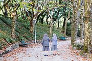 SANTIAGO DE COMPOSTELA, SPAIN - 14th of October - Two nuns walk through Alameda park, Santiago de Compostela, Galicia, Northern Spain.