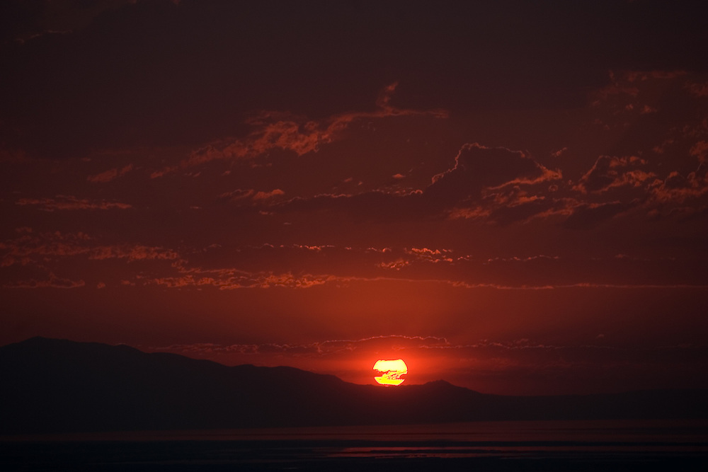Sunset over Antelope Island from our home in Bountiful on July 12, 2006. August Miller