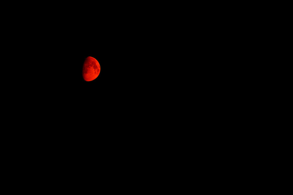 Reddish moon on a night with heavy smoke from forest fires in Eastern Oregon.