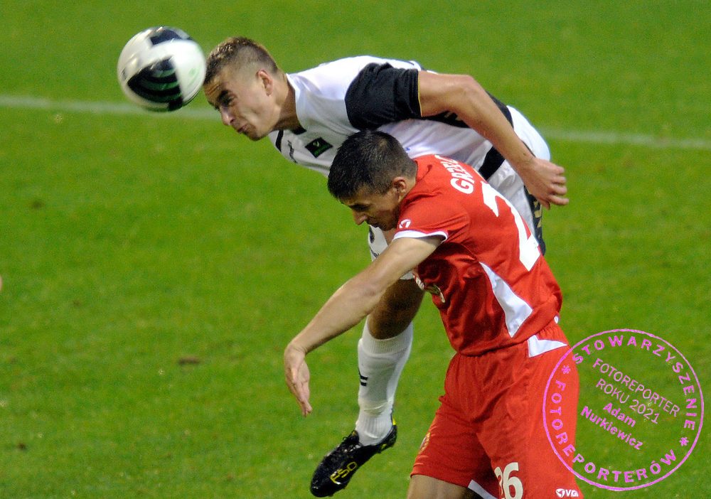(L) ARTUR SOBIECH (POLONIA) & (R) PIOTR GRZELCZAK (WIDZEW) FIGHT FOR THE BALL DURING 4. ROUND SEASON 2010/2011 EXTRALEAGUE SOCCER MATCH BETWEEN WIDZEW LODZ AND POLONIA WARSZAWA AT WIDZEW'S STADIUM IN LODZ...LODZ , POLAND , AUGUST 28, 2010..( PHOTO BY ADAM NURKIEWICZ / MEDIASPORT )