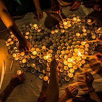 Malaysian lights a candles in love shape  during an event Love U MH370  in Kuala Lumpur, Malaysia 30 March 2014.  Ships searching for missing flight MH370 have retrieved floating objects from the Indian Ocean, but they were not related to the lost jet, Australian authorities said on 29 March 2014.