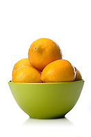 Studio shot of lemons in green bowl