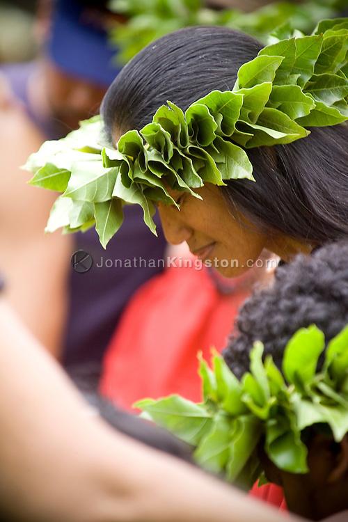 MOLOKAI, HI - Wearing a leaf lei headdress a woman prepares to perform at Ka Hula Piko, a festival celebrating the birth of the hula on Molokai, Hawaii.  Ka Hula Piko began in 1991, and was founded by Kumu Hula John Ka'imikaua, Halau Hula O Kukunaokala and the Moloka'i Community. Molokai is widely held to be the birthplace of the hula.